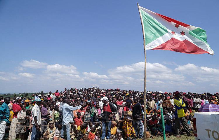 Residents gather for a ceremony in Bugendana in June 2018 to mark the adoption of Burundi's new constitution. Three radio journalists covering a land dispute in the country's capital in August 2018 say police harassed and attacked them. (STR/AFP)