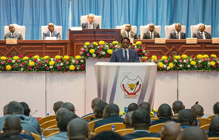 Democratic Republic of Congo President Joseph Kabila delivers a state of the nation speech in Kinshasa on July 19, 2018. Authorities in the DRC jailed a journalist for criminal defamation on September 6. (AFP/Junior D. Kannah)