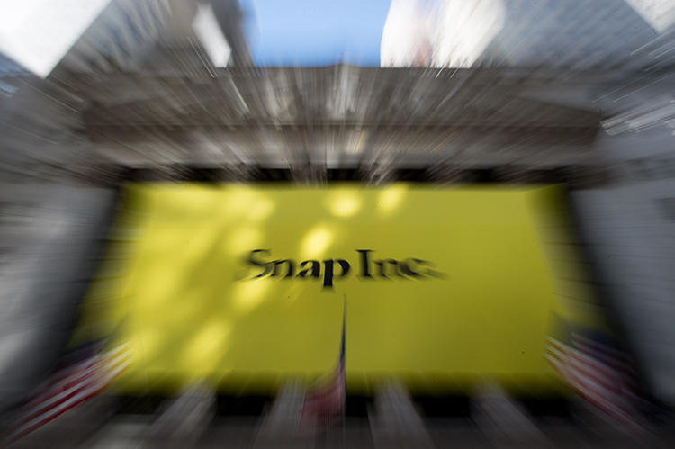 A Snap banner covers the facade of the New York Stock Exchange in March 2017. The social media company's transparency report shows it received and complied with three government takedown requests for the Al-Jazeera Discover channel. (AFP/Bryan R. Smith)