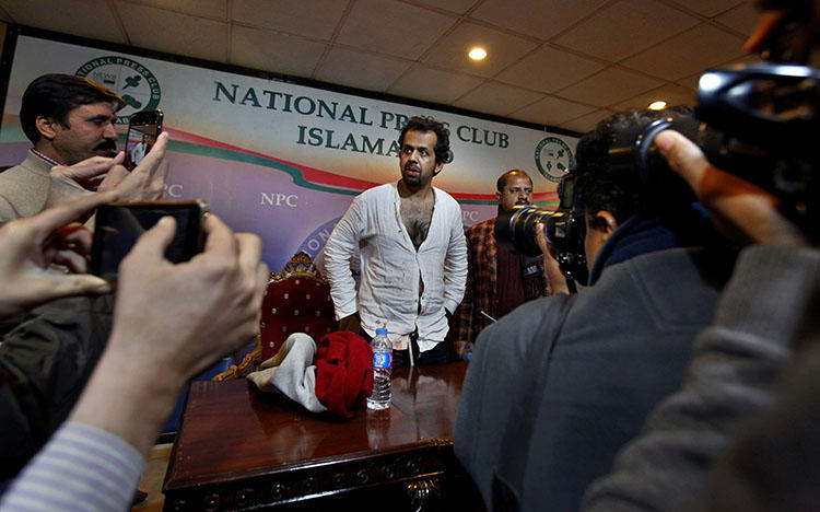 Reporter Taha Siddiqui, center, speaks at a January 2018 press conference about an attempted kidnapping that he believes is connected to his reporting on Pakistan's military. (AP/Anjum Naveed)