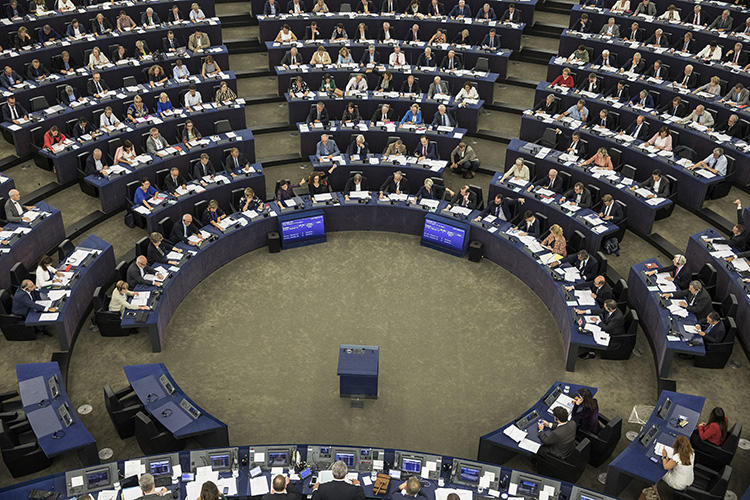 Members of the European Parliament take part in a vote in Strasbourg, France, on September 12, 2018. EU lawmakers voted in favor of a resolution to trigger Article 7 of the Treaty of the European Union against Hungary for breaching EU values. (AP Photo/Jean-Francois Badias)
