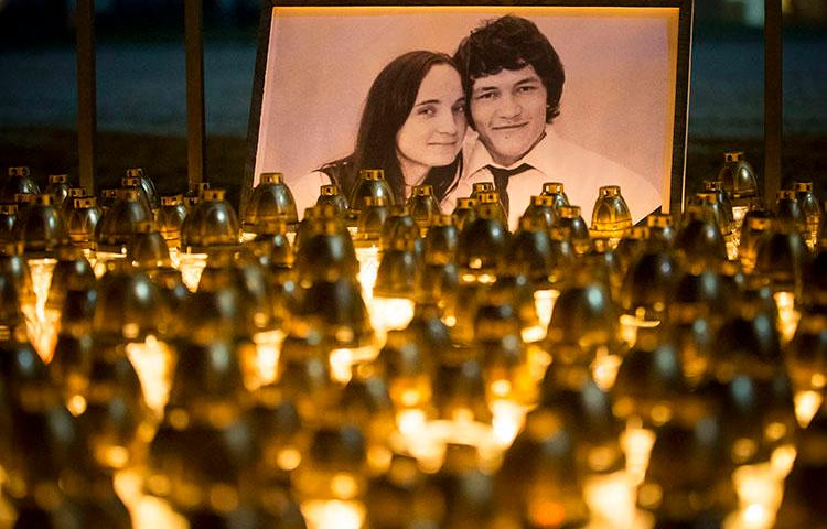 A memorial for investigative reporter Ján Kuciak and his fiancée, Martina Kušnírová, is held in Bratislava in February. Slovak police in September charged three people with the couple's murder. (AP/Bundas Engler/file)