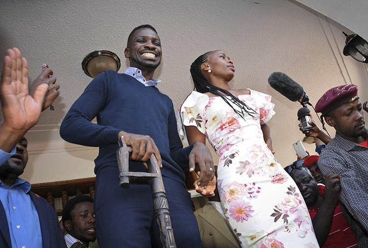 Opposition MP Kyagulanyi Ssentamu, known as Bobi Wine, and his wife Barbara Itungo Kyagulanyi, pictured at their home in Kampala, on September 20. Police detained at least eight journalists who were covering Bobi Wine's return to Uganda from the U.S. (AP/Ronald Kabuubi)