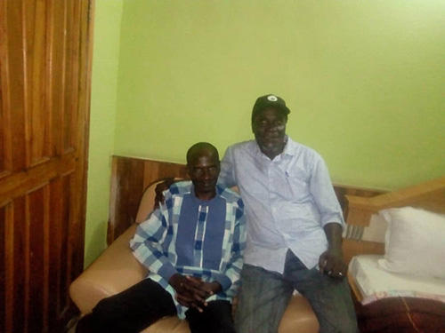 Nigerian journalist Jones Abiri, left, and a friend after the journalist's release from prison. (Alagoa Morris)