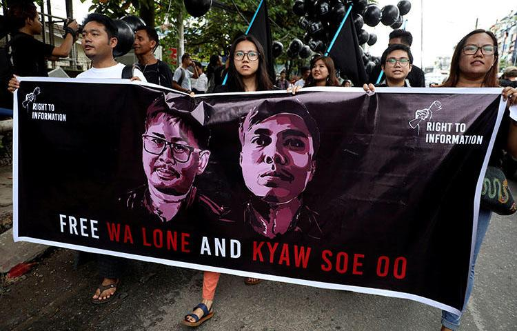 People march to show solidarity for jailed Reuters journalists Wa Lone and Kyaw Soe Oo in Yangon, Myanmar, on September 1, 2018, two days before a local court sentenced them to 7 years in prison on charges of breaching the country's Official Secrets Act. (Reuters/Ann Wang)