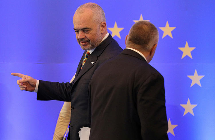 Bulgarian Prime Minister Boyko Borissov stands by the EU flag at a conference in Sofia, in December 2017. Police in Bulgaria briefly detained two journalists investigating allegations of fraud involving EU funds. (Reuters/Stoyan Nenov)
