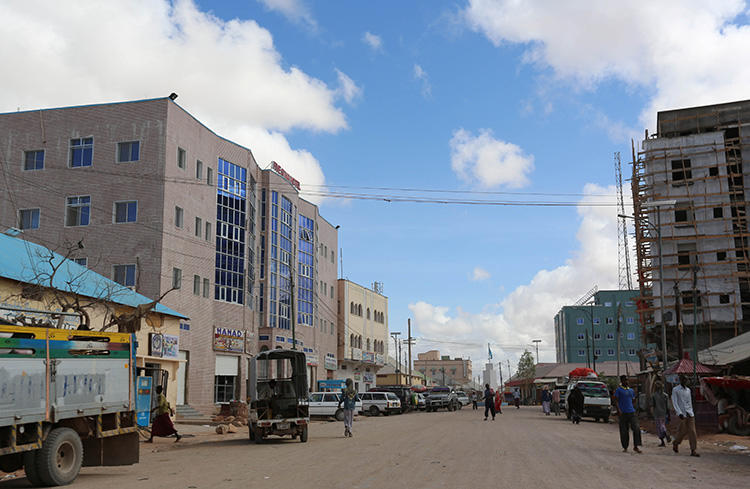A general view shows people walking along a street in Galkayo on April 21, 2015. A radio reporter and photographer was killed in Galkayo on September 19, 2018. (Reuters/Feisal Omar)