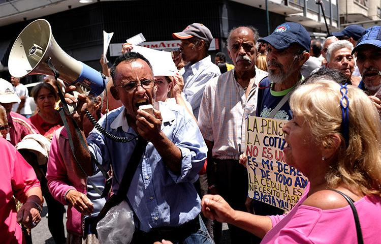People attend a retirees protest in Caracas, Venezuela, on August 29, 2018. A Venezuelan freelance photographer was detained and sent to a military prison in late August. (Reuters/Marco Bello)