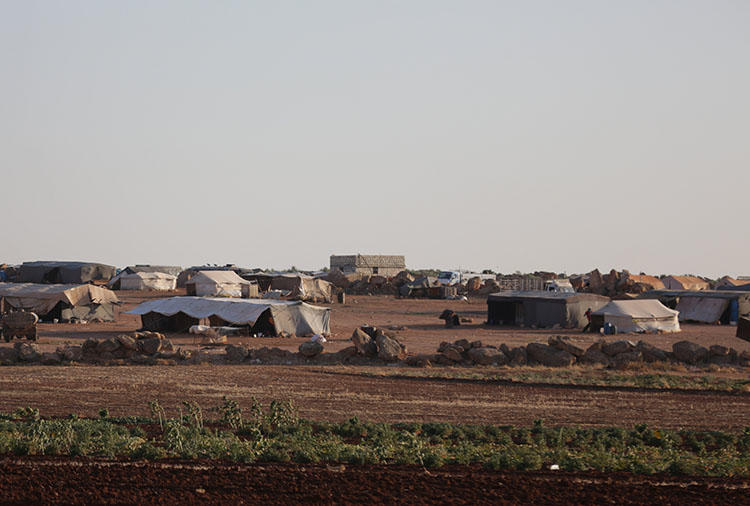 Tents are shown at a refugee camp for internally displaced Syrians in Idlib province on July 30, 2018. Syrian authorities arrested a news anchor for Iraqi Kurdish broadcaster Rudaw, who had recently discussed on air fears of a large-scale military offensive on the province. (Reuters/Khalil Ashawi)