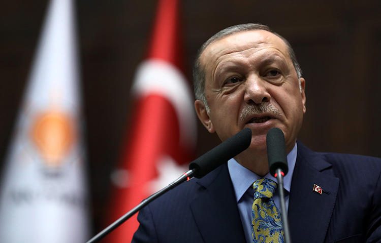 President Recep Tayyip Erdoğan addresses members of Turkey's parliament in Ankara on October 16, 2018. A court convicted three journalists of insulting the president in the pro-Kurdish daily Özgür Gündem. (AFP/Adem Altan)