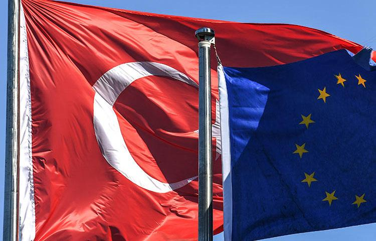 Turkish and European Union flags pictured in Istanbul's financial and business district in August. Turkey continues its crackdown on press freedom, with more journalists detained and questioned over their reporting this week. (AFP/Ozan Kose)
