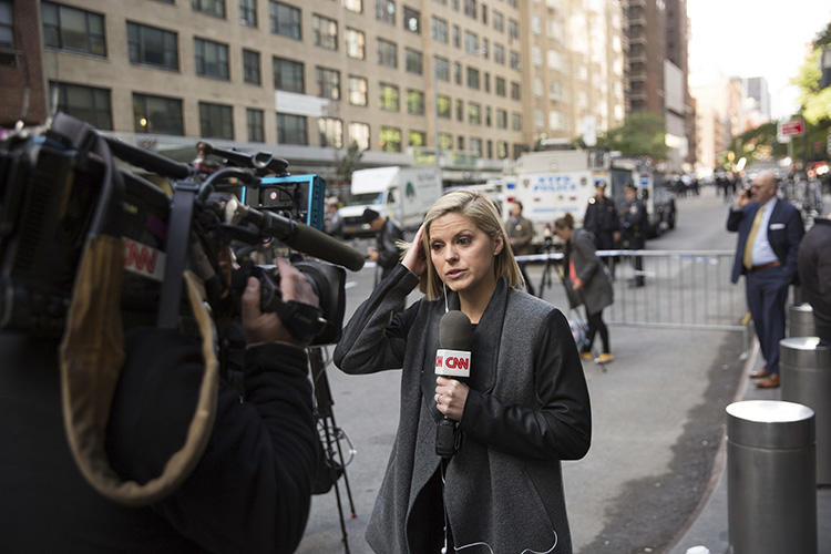CNN correspondent Kate Bolduan reports from outside the Time Warner Building in New York City on October 24, as police remove an explosive device from the CNN offices. (AP/Kevin Hagen)