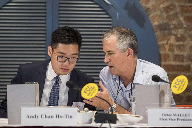In this August 14, 2018, photo, Victor Mallet, Financial Times Asia news editor, right, speaks with Andy Chan, founder of the Hong Kong National Party, at the Foreign Correspondents Club in Hong Kong. Hong Kong's government has declined to renew Mallet's work visa. (AP)