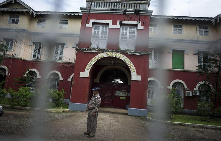 An officer stand guards before Insein prison in Yangon, Myanmar. Three journalists from Eleven Media were remanded to the prison after raising questions about public spending in Yangon. (Ye Aung Thu/AFP)