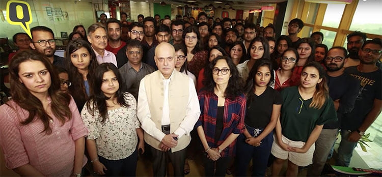 Journalist Raghav Bahl, center, is seen in this screen grab with staff at The Quint. Tax officials raided the website's offices and Bahl's home on October 11.