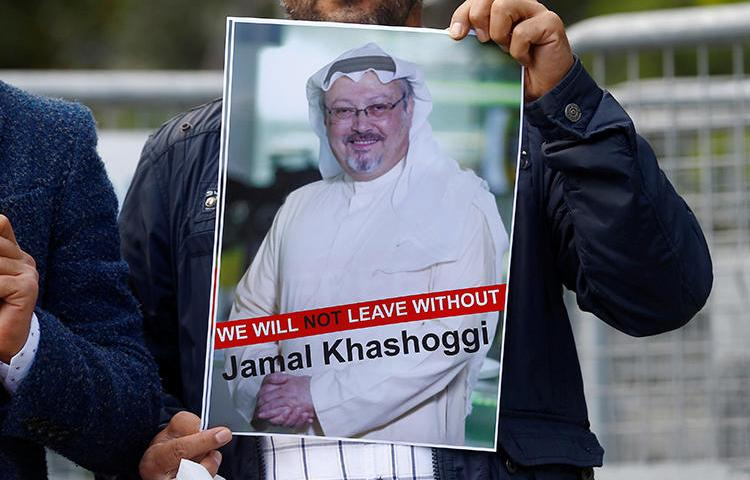 A demonstrator holds a picture of Saudi journalist Jamal Khashoggi during a protest in front of Saudi Arabia's consulate in Istanbul, Turkey, on October 5, 2018. Khashoggi has not been seen since entering the consulate on October 2. (Reuters/Osman Orsal)