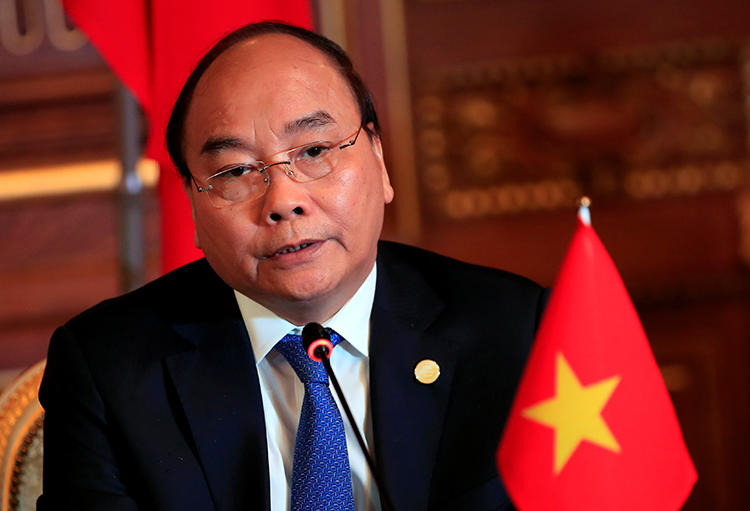 Vietnamese Prime Minister Nguyen Xuan Phuc attends a news conference in Tokyo, Japan, on October 9, 2018. Vietnam sentenced a citizen journalist to prison on an anti-state charge on October 12. (Franck Robichon/Pool via Reuters)