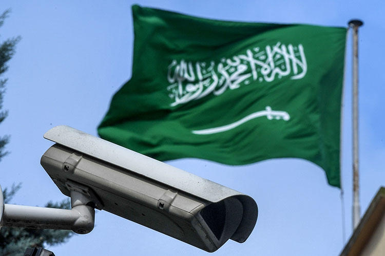 A Saudi Arabia flag and a surveillance camera are seen in the backyard of the Saudi Arabian consulate in Istanbul. Saudi actors are believed to have spied on phone calls and messages between murdered journalist Jamal Khashoggi and his friend, Saudi dissident Omar Abdulaziz. (AFP/Ozan Kose)