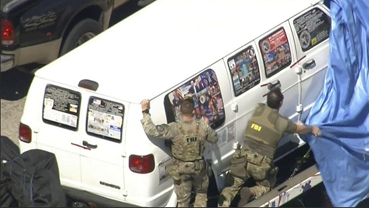 In this video screen shot, FBI agents cover a van being transported from Plantation, Florida, on October 26, 2018, that federal agents and police officers have been examining in connection with package bombs sent to CNN and high-profile critics of President Donald Trump. (WPLG-TV via AP)