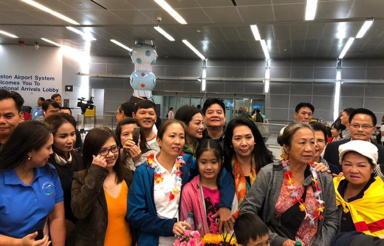 """Vietnamese blogger Nguyen Ngoc Nhu Quynh, known by her pen name """"Mother Mushroom,"""" (center, in white) with a group of supporters upon her arrival at the airport in Houston, Texas, on Thursday. (Danlambao News)"""