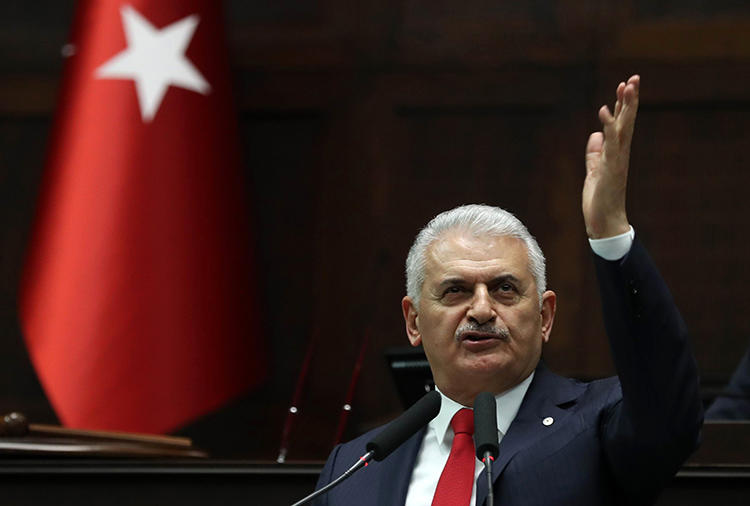 Binali Yıldırım, pictured giving a speech at Turkey's Grand Assembly in March 2018. A court ordered the daily Evrensel to pay damages to the former prime minister over its caricature of him. (AFP/Adem Altan)
