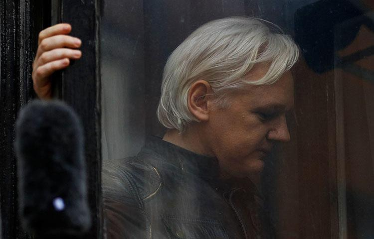 WikiLeaks founder Julian Assange is seen on the balcony of the Ecuadoran Embassy in London, U.K., on May 19, 2017. (Reuters/Peter Nicholls)