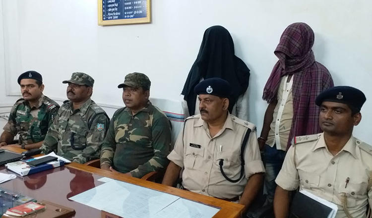 Two suspects, with their faces covered, are brought out at a press conference on the killing of Indian journalist Chandan Tiwari. (Handout)