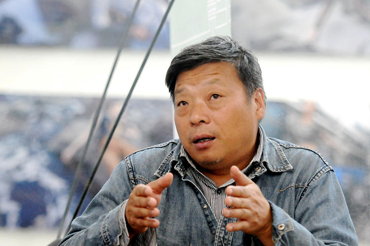 Lu Guang, pictured at the Pingyao International Photography Festival in Shanxi province in September 2014. Chinese police detained the photographer in early November. (Reuters/China Stringer Network)