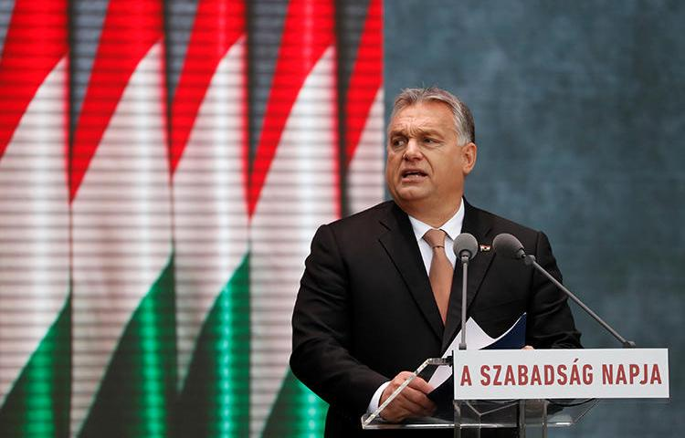 Hungarian Prime Minister Viktor Orban delivers a speech during the celebrations of the 62nd anniversary of the Hungarian Uprising of 1956, in Budapest, Hungary, on October 23, 2018. Hungarian authorities brought criminal charges against a prominent investigative journalist on October 18. (Reuters/Bernadett Szabo)