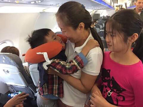 Nguyen Ngoc Nhu Quynh, Vietnamese journalist and CPJ's 2018 award winner, on a plane after being released from prison. (Family photo)