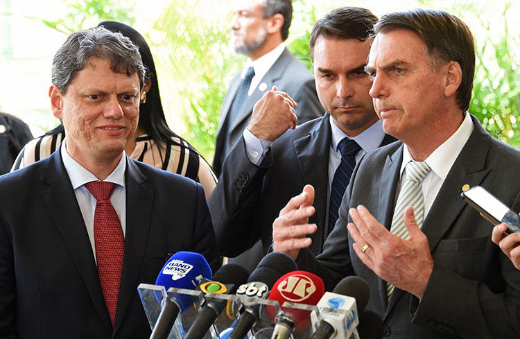 Brazil's new president, Jair Bolsonaro, right, talks to the press in Brasília on November 27. Journalists in Brazil say they expect the hostile climate experienced during the election to continue as Bolsonaro takes office. (AFP/Evaristo Sa)