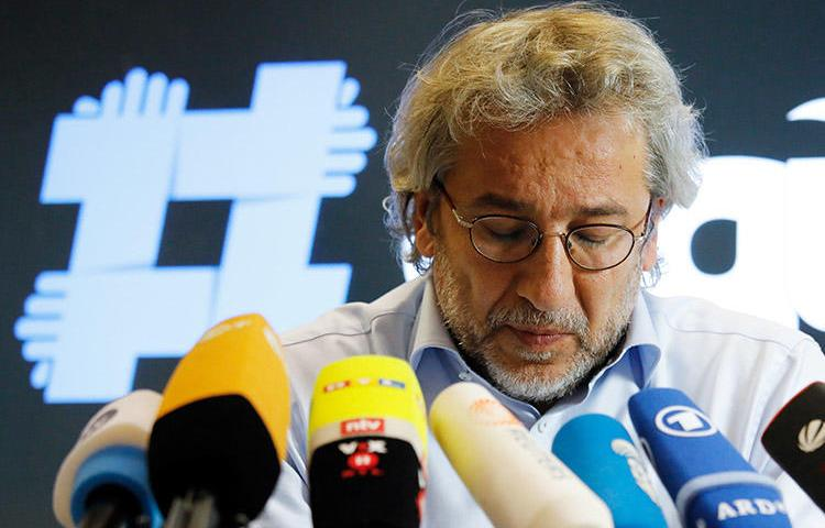 Turkish journalist Can Dündar, pictured at a press conference in Berlin in September. Turkey has issued a new arrest warrant for the former chief editor. (AFP/David Gannon)