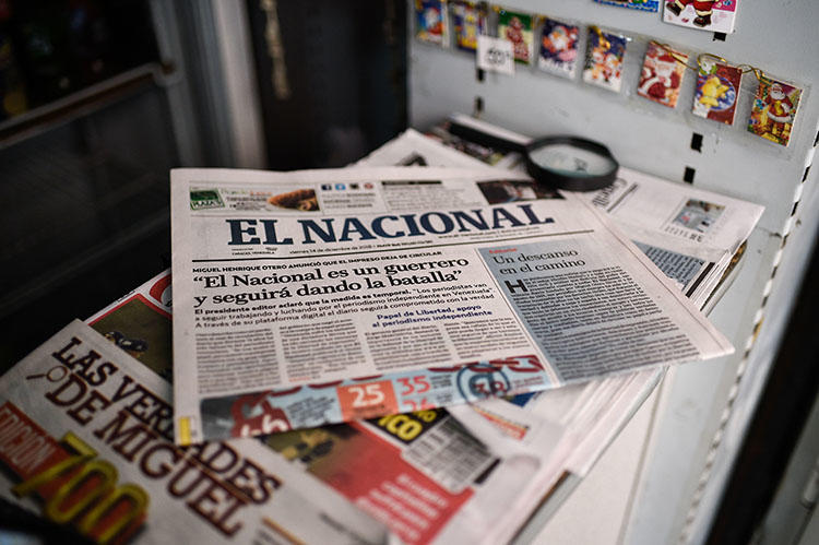 A copy of the last print edition of El Nacional, with a headline that reads 'El Nacional is a warrior and will keep on fighting,' on December 14. The daily is the latest Venezuelan publication forced to run online only because of limited access to newsprint. (AFP/Federico Parra)