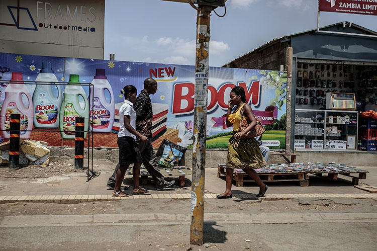 People walk in Lusaka's business district in November 2014. A journalist was jailed in the city in December 2018 for contempt of court. (AFP/ Gianluigi Guercia)