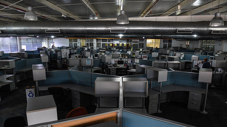 The near deserted newsroom of Caracas daily El Nacional, pictured in October. Like many Venezuelan outlets, several of its journalists are in exile to escape legal action and the deepening economic crisis. (AFP/Federico Parra)