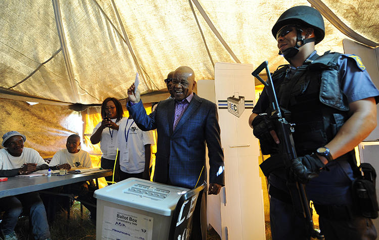 Lesotho Prime Minister Thomas Thabane casts his vote in Maseru, Lesotho, on February 28, 2015. Lesotho's military spokesman threatened an investigative journalist over her reporting in a December 5, 2018, letter. (AP Photo)