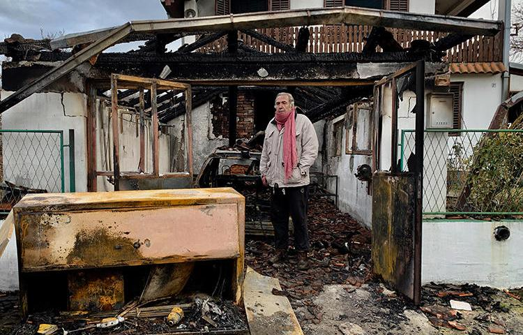 Serbian investigative journalist Milan Jovanović stands in the ruins of his home in the Belgrade suburb of Vrčin. His home was burned down in an arson attack on December 12, 2018. (Cenzolovka)