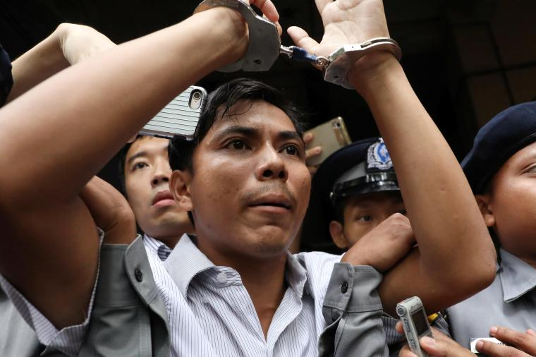 Reuters journalist Kyaw Soe Oo is led handcuffed from a court in Yangon in September. He and colleague Wa Lone are serving seven-year prison sentences in Myanmar. (Reuters/Ann Wang)