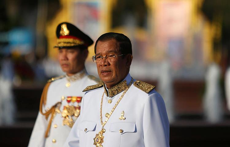 Cambodian Prime Minister Hun Sen attends celebrations marking the 65th anniversary of the country's independence from France, in Phnom Penh, Cambodia, on November 9, 2018. A Cambodian news fixer was deported from Thailand to Cambodia on a 'false news' accusation on December 12. (Reuters/Samrang Pring)