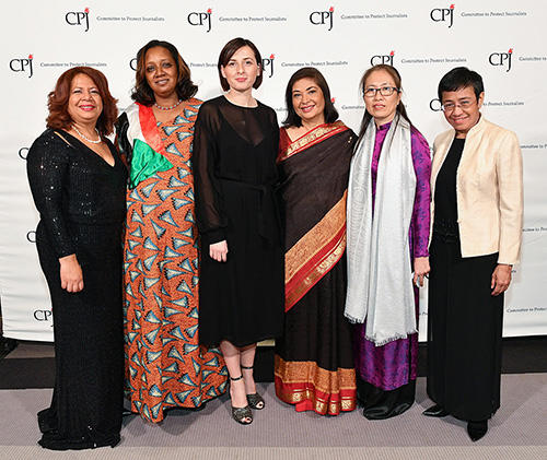CPJ's 2018 awardees with Meher Tatna, president of the Hollywood Foreign Press Association and the 2018 dinner chair, third from right. (Getty Images/Dia Dipasupil)