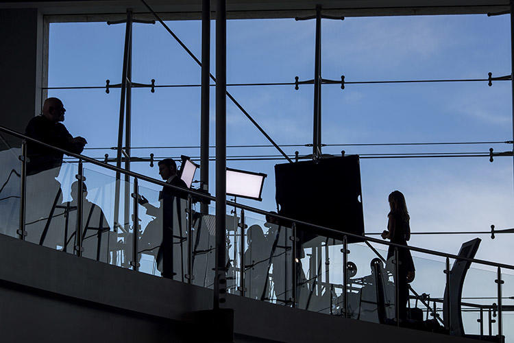 News crews set up inside in the Air Force One Pavilion in 2016 to report of the passing of former First Lady Nancy Reagan. Female journalists working for local broadcasters across the U.S. have spoken of the threats and unwanted attention they have to deal with. (Getty Images/AFP/David McNew)
