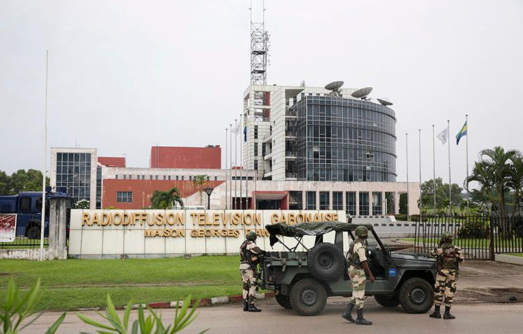 Gabonese soldiers stand in front of the headquarters of the national broadcaster in Libreville on January 7, 2019, after a failed coup. Gabon shut down the internet and broadcasting services following the coup attempt. (AFP/Steve Jordan)
