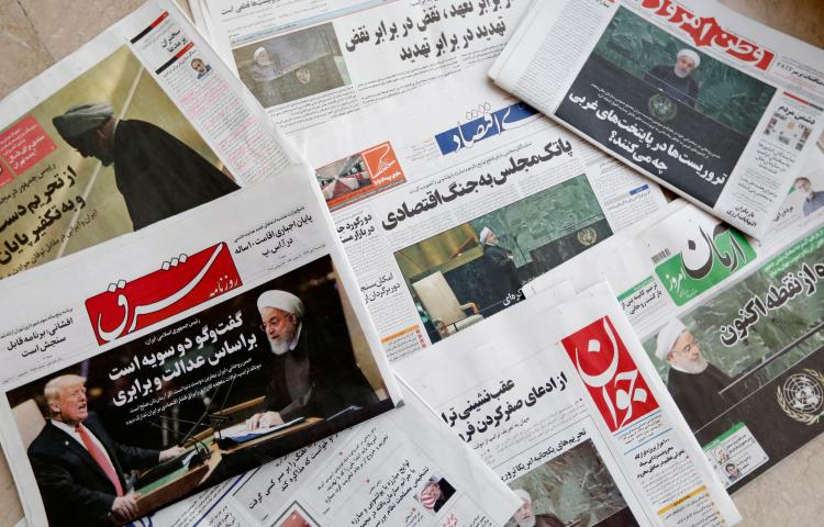 A picture taken on September 26, 2018, shows the front pages of Iranian newspapers at a newspaper stand in the capital Tehran. Iran jailed a journalist for six years over his critical writing on December 25, 2018. (AFP/Atta Kenare)