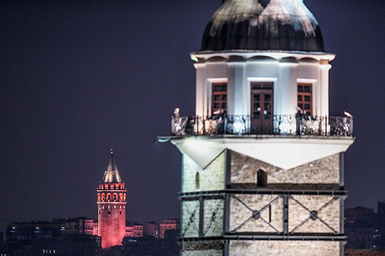 A view of Maiden's Tower, front, and Galata Tower, in Istanbul. A court in the city has sentenced Turkish journalist Ayşe Nazlı Ilıcak to an additional five years in prison. (AFP/Ozan Kose)