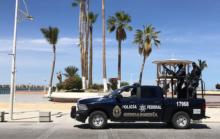Agents of the Federal Police patrol in Baja California Sur state, Mexico, on March 12, 2018. On January 29, 2019, journalist Martín Valtierra García was beaten by two unknown assailants outside his home in Comondù, Baja California Sur. (Daniel Slim/AFP)
