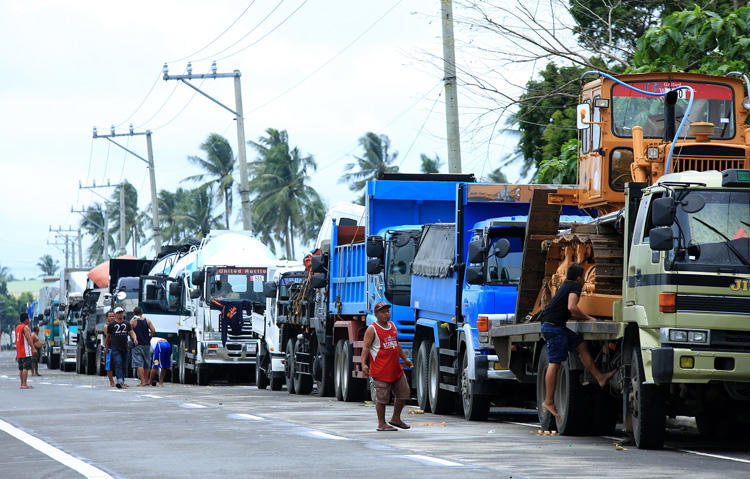 Vehicles on a highway heading to the port in Matnog, Sorsogon, the Philippines, on December 17, 2017. A radio broadcaster was killed in Sorsogon City on January 9, 2018. (AFP/Charism Sayat)