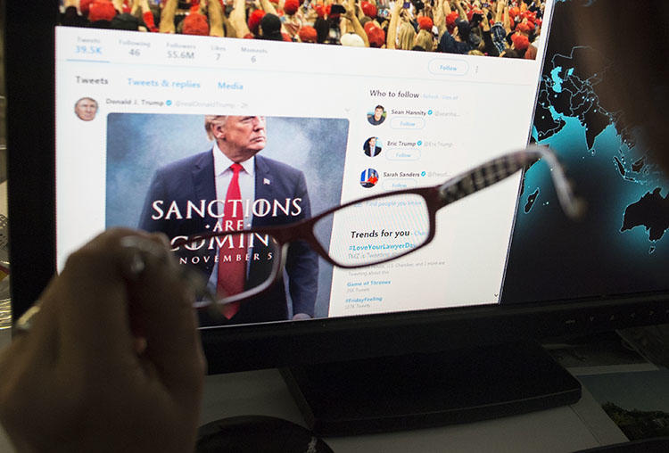 A woman looks at the Twitter feed of President Donald Trump in November 2018. Trump uses Twitter to make policy announcements and also to rail against critical press coverage. (STF/AFP)