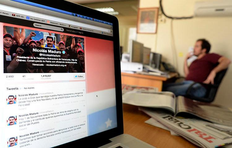 View of a computer screen showing the Twitter account of Venezuelan President Nicolas Maduro, in Caracas. A proposed law in Venezuela would expand the powers of the government to control and monitor internet use without institutional checks. (Juan Barreto/AFP)