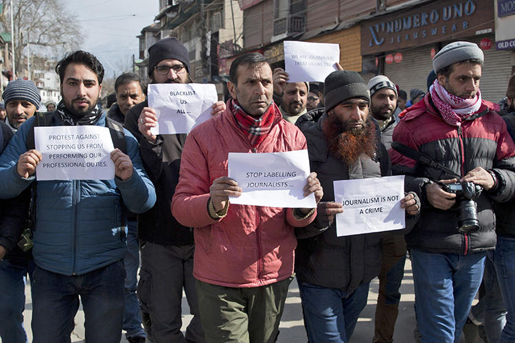 Kashmiri journalists hold placards during a protest march in Srinagar, Indian controlled Kashmir, on Saturday, January 26, 2019. Dozens of journalists marched in protest after authorities barred 10 journalists from entering the venue of India's Republic Day parade in the disputed region's main city. (Dar Yasin/AP)