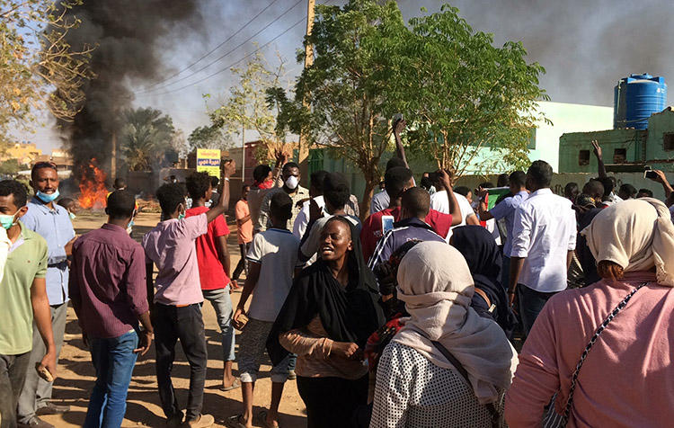 An anti-government rally in Khartoum on January 13. Several journalists are detained and Sudanese authorities are censoring newspapers to try to limit coverage of the unrest. (AP)